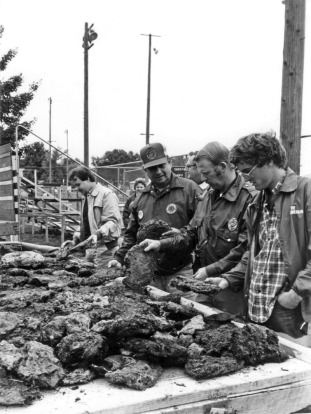 Steve Lees, Dick Tyson, Jim Brown (with pipe), and unknown at 1982 Oktoberfest cow chip throwing contest